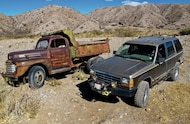 ford explorer next to old rusty truck