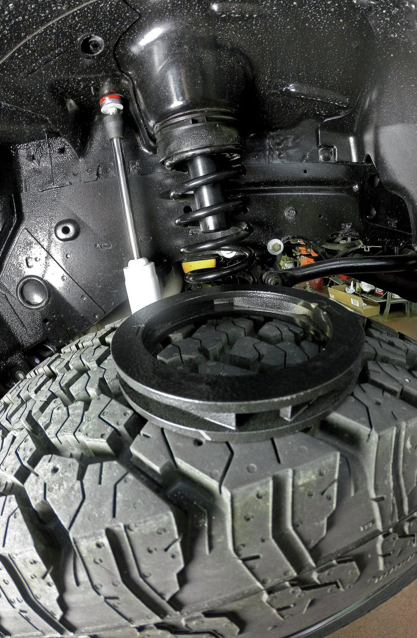 With a considerable amount of additional weight now hanging off the front end of our WJ, we compensated for spring-sag with a pair of Rough Country 3⁄4-inch coil spacers. Thanks to the impressive amount of axle droop that the IRO long-arm suspension offers, we were able to yank the coil springs out by hand and install the spacers in a matter of minutes. The Jeep still has a noticeable front-end rake, but the spacers did the trick for now; higher-rate coils may be in our future, however.