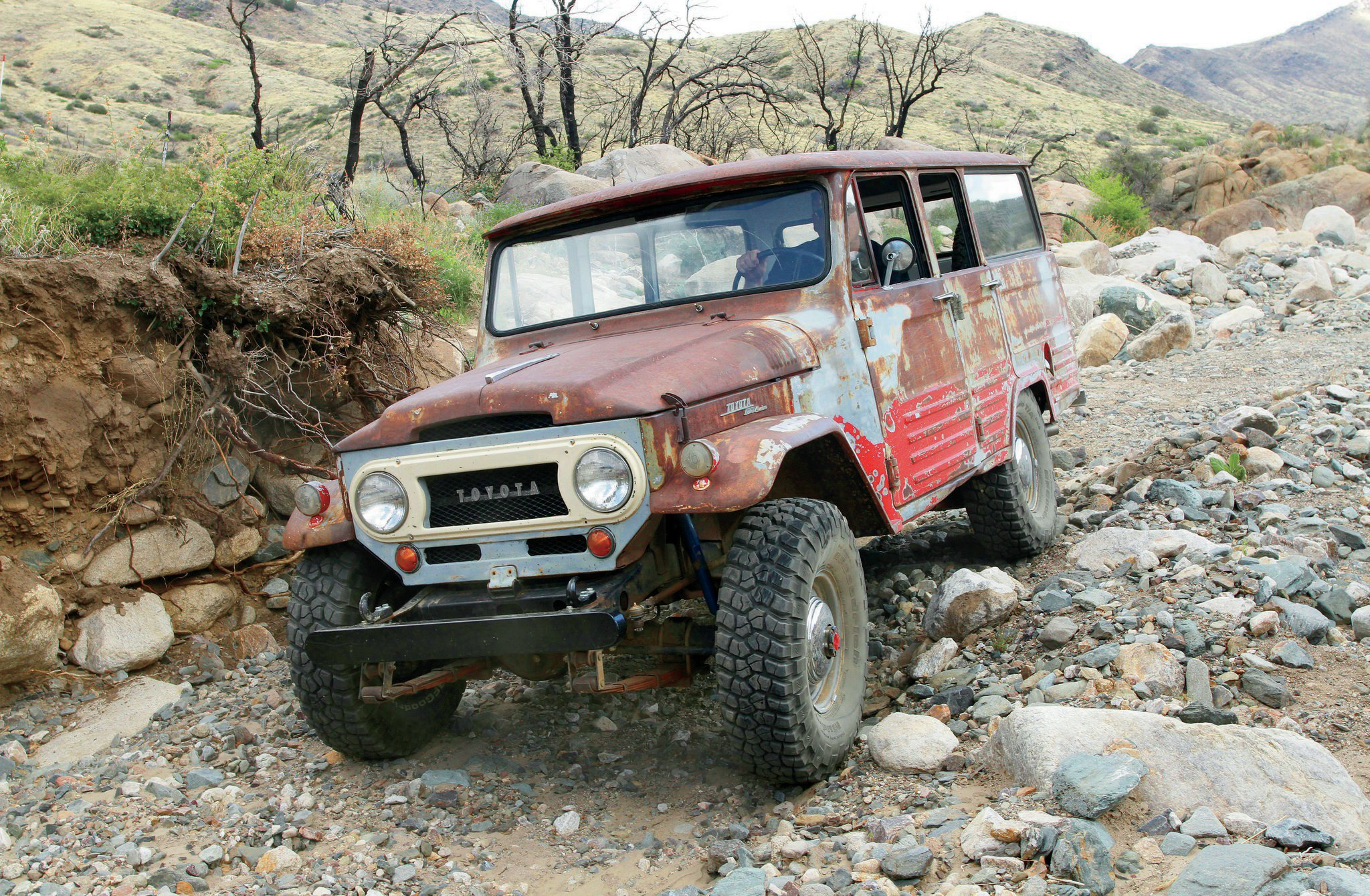 These wagons share the same front clip as the popular FJ40 series rigs, and the frame is the same one that was used on the short-wheelbase FJ45 pickups. Treads are fresh 33x10.5R15 BFGoodrich KM2 tires mounted to vintage Cruiser steel wheels. Rob Bonney supplied the rare early hubcaps at each wheel.
