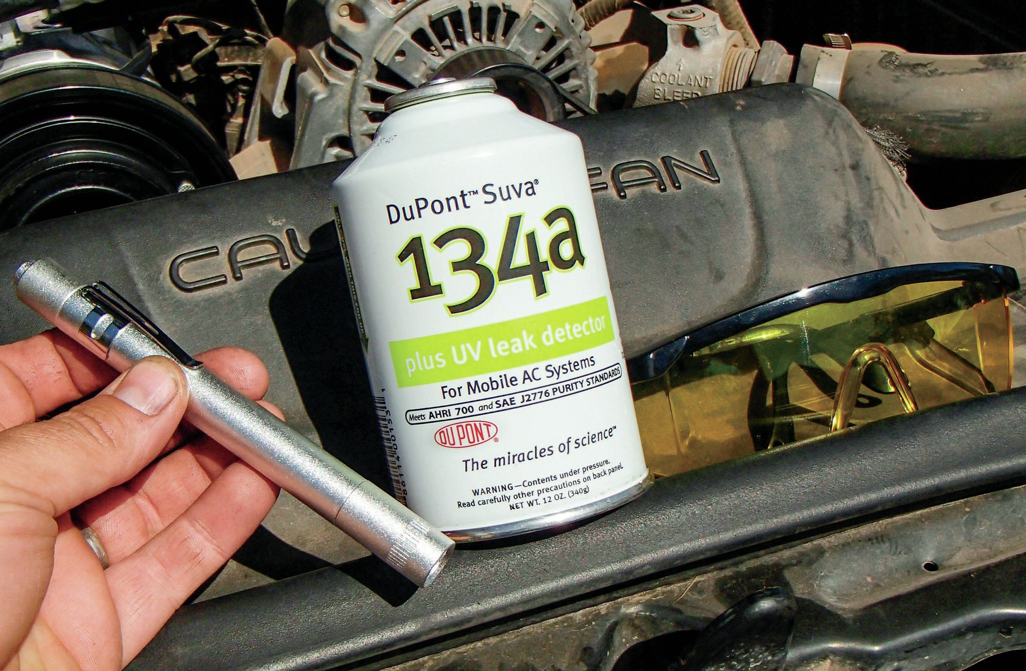 If your once fully functioning A/C system slowly warms up over a few days or weeks, chances are you have a small leak somewhere in the system where the r134A is escaping. You can use soapy water and a spray bottle to look for a leak on the system, or internally add some r134A with a specially die and use this funky little light and these yellow glasses to find the leak. The dye works its way out of the leak and the light and glasses make the area where the leak is light up like Tide detergent under a black light. In theory, this will make finding the leak easy. Again, be sure to avoid any leak dye with any A/C system leak sealer mixed in.