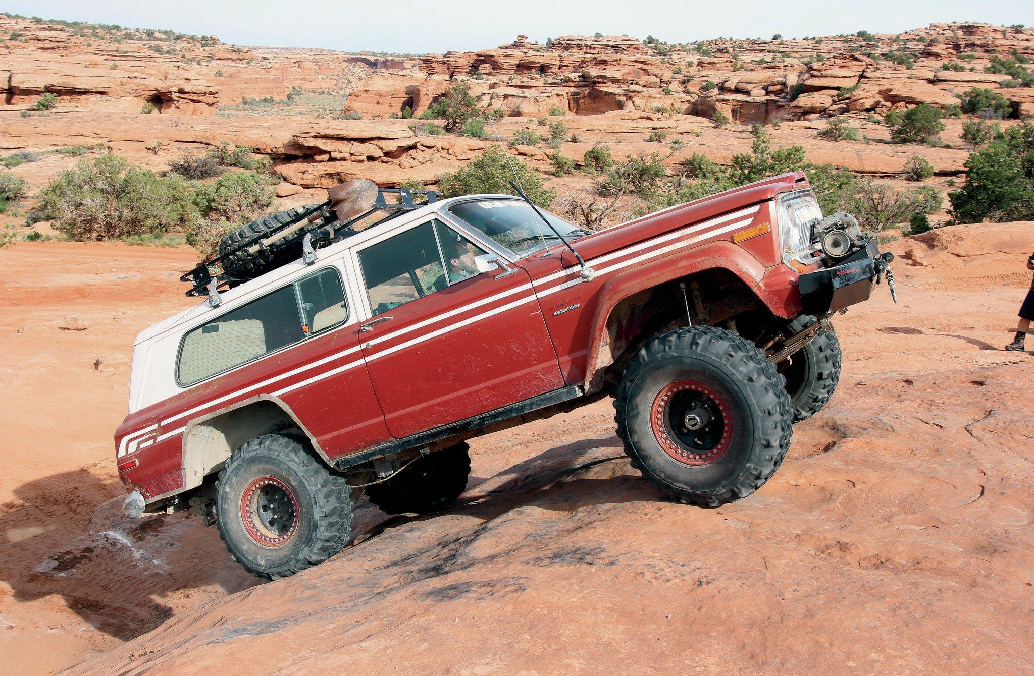 1977 Jeep FSJ front three quarter