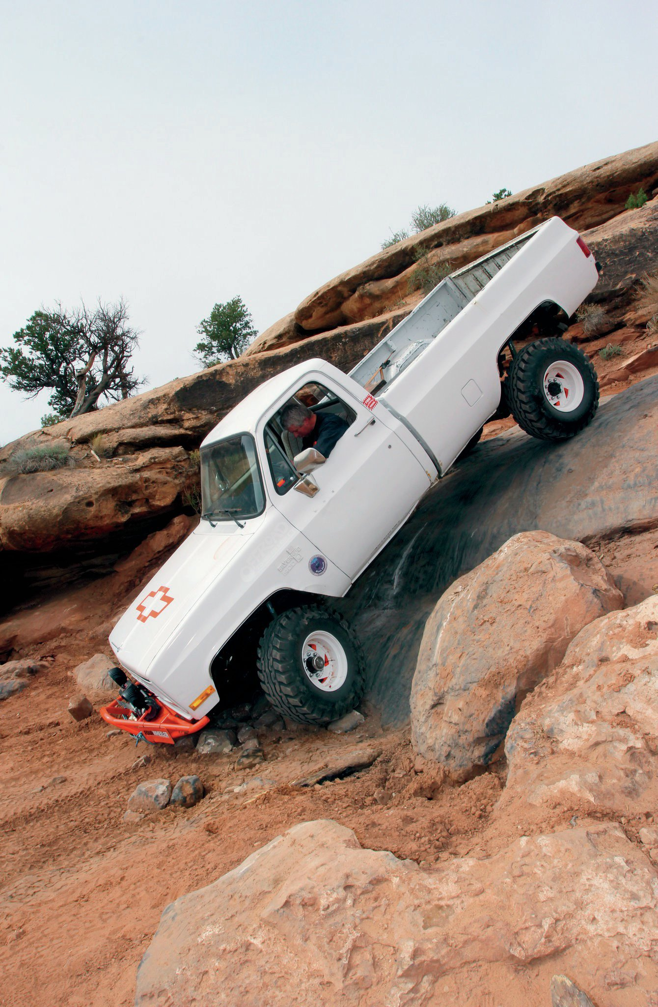 """Tom Cherry, the birthday boy of the Fullsize Invasion, showed that wheeling a longbed truck is not only possible, it's possible to do well. His 1986 Chevy K30 sports a built 400ci V-8, Edelbrock Pro-Flow fuel injection, SM465 four-speed transmission, NP208 T-case, Detroit Locker-equipped Dana 60 front axle, Detroit Locker-equipped GM 14-bolt rear axle, 4.56 gears, 4-inch suspension lift, Bilstein shocks, and 36-inch tires. On his tech sheet, Cherry wrote, """"I have no money. My budget is if I can't trade for it or get it for free, it don't happen. Being here is my birthday present, and today, April 16, is my birthday."""""""