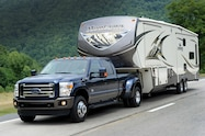 2015 Ford F 350 Super Duty King Ranch front three quarter in motion 03