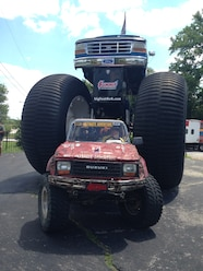 Ultimate Adventure 2014 Day 7 Road Day  18  Tim Hardy Suzuki Samurai under Bigfoot Monster Truck.JPG