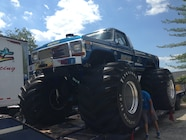 Ultimate Adventure 2014 Day 7 Road Day  36  UA Crew checking out Bigfoot Monster Truck.JPG