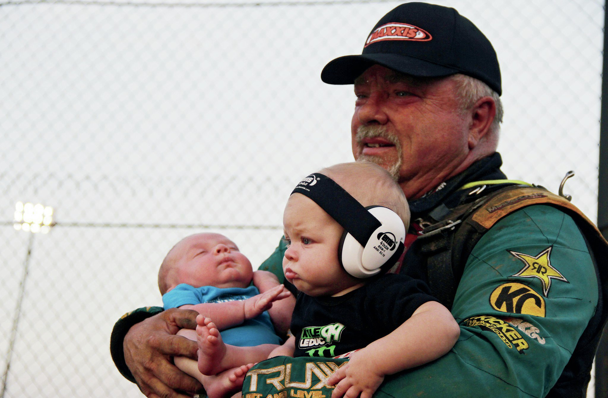 Curt Leduc holds his grandchildren after getting on the podium at the 2013 Lucas Oil Off-Road Racing Series Glen Helen Pro-4 race.