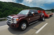 2015 Ford F 450 Super Duty Platinum front three quarter in motion