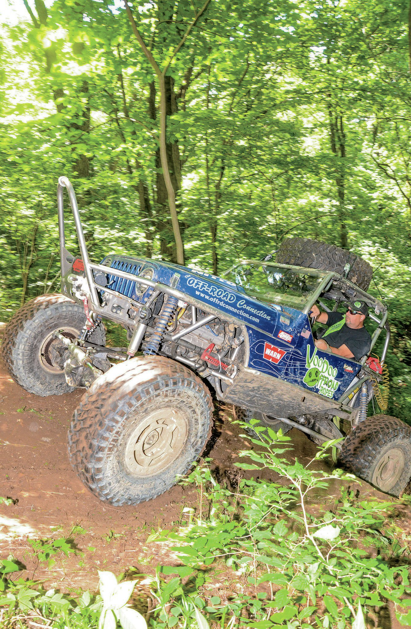 Keith Bailey shows how it's done in his Jeep based Buggy. The buggy runs a Hemi for power. Last year Tom Boyd blew Bailey's rear ring-and-pinion on one particularly gnarly climb. Since then the Buggy's high-pinion Dana 60 rear axle has been replaced with a shaved 14-bolt axle.