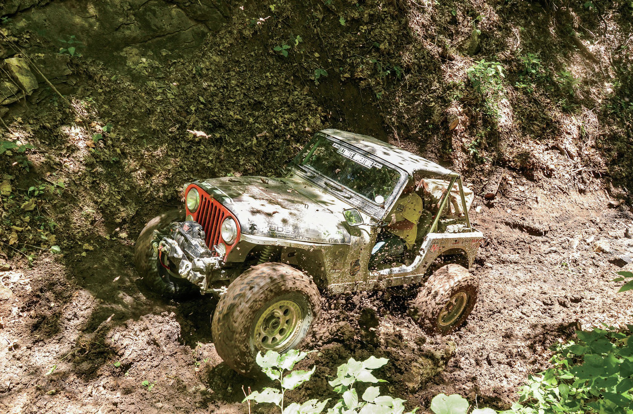 General Péwé slings some mud in UA 2010's own CJ-17. These slick, large rocks at the bottom of Bad Dog on the Atlas Trail made getting a good run at the hillclimb difficult, if not impossible.