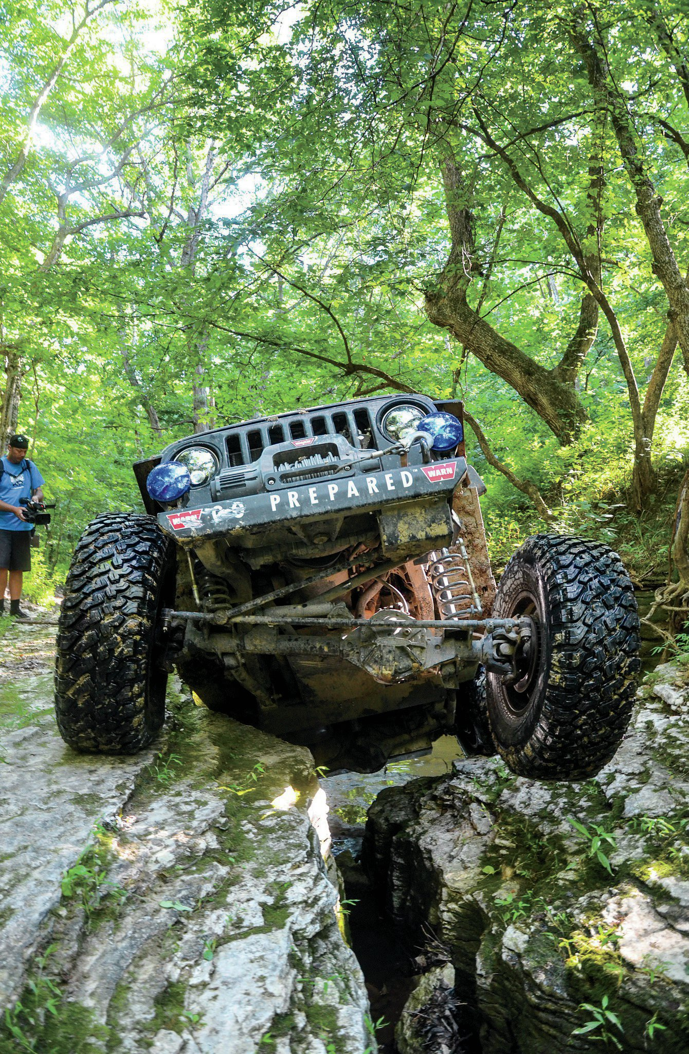 Chris Durham has a pretty solid formula for building a capable yet road drivable UA rig. This year he was behind the wheel of a friend's '04 TJ. Because the rig was kept low and stable, Durham has confidence when he aims the wheels at very difficult lines. He is pretty good at one-shotting most obstacles. Here he crawls the crack called Can Opener on a Pike County, Illinois, trail known as the Mystery Trail. <p></p><p></p>