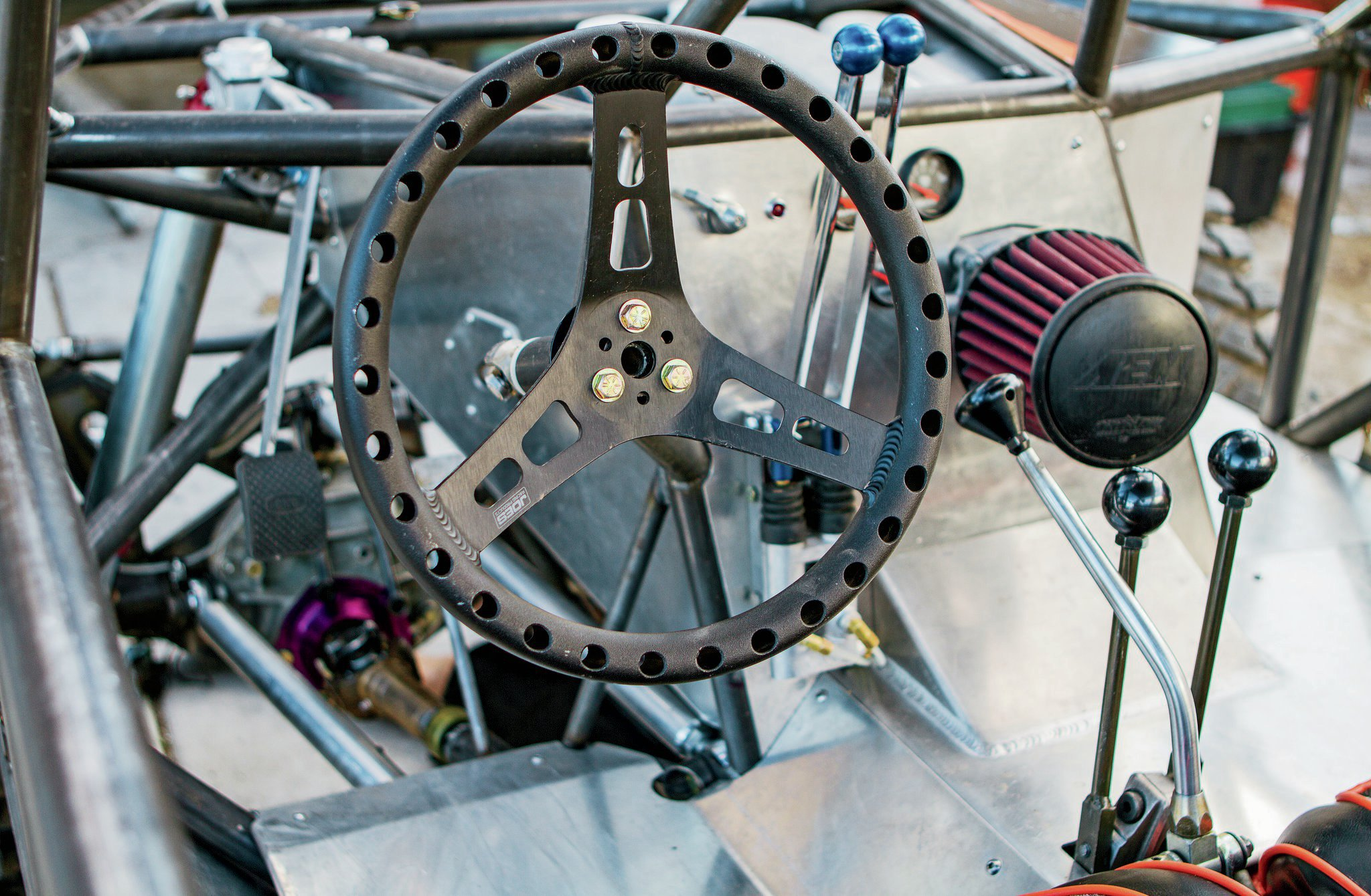 Steering consists of a Trail Gear full hydraulic system with the orbital valve mounted low on the chassis behind the custom aluminum firewall. This provides increased safety compared to mounting the orbital valve at the steering column and it gives Jesse an unimpeded forward view of crawling courses.