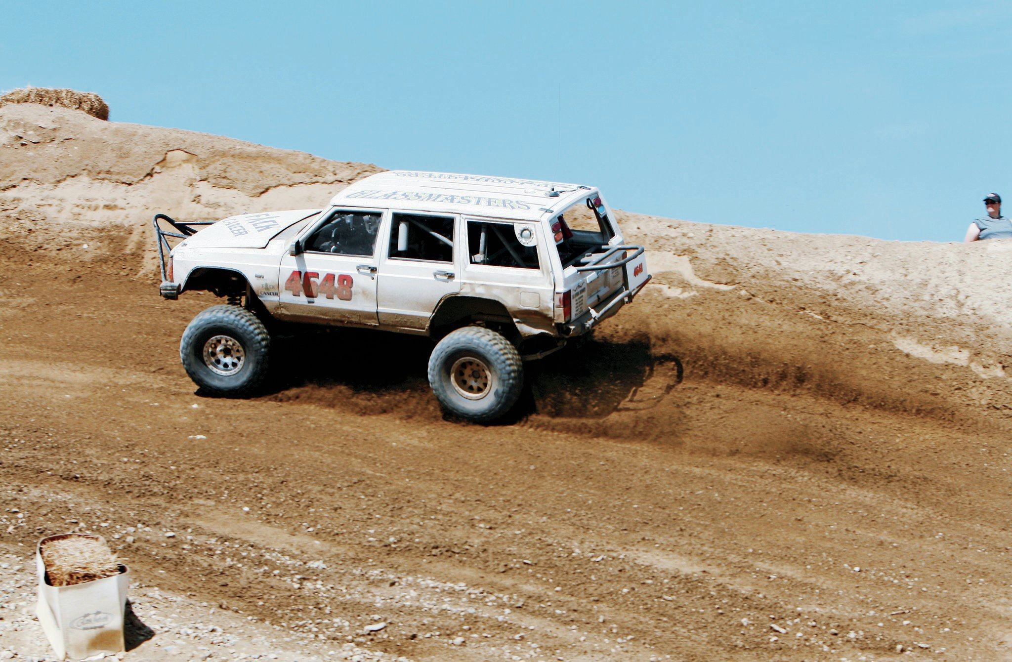 The Behrend Brothers of B and B Racing have fun on a budget. Their $500 XJ is sponsored by Brian Behrend's glass shop and a few friends' businesses. It demonstrates that Ultra4's 4600 Class can be entered somewhat affordably.