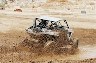 utv racing through mud