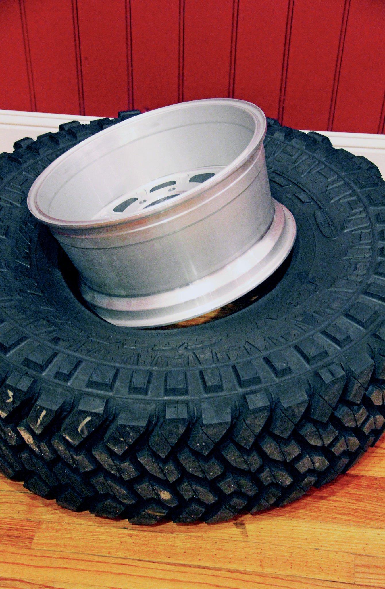 putting wheel in tire