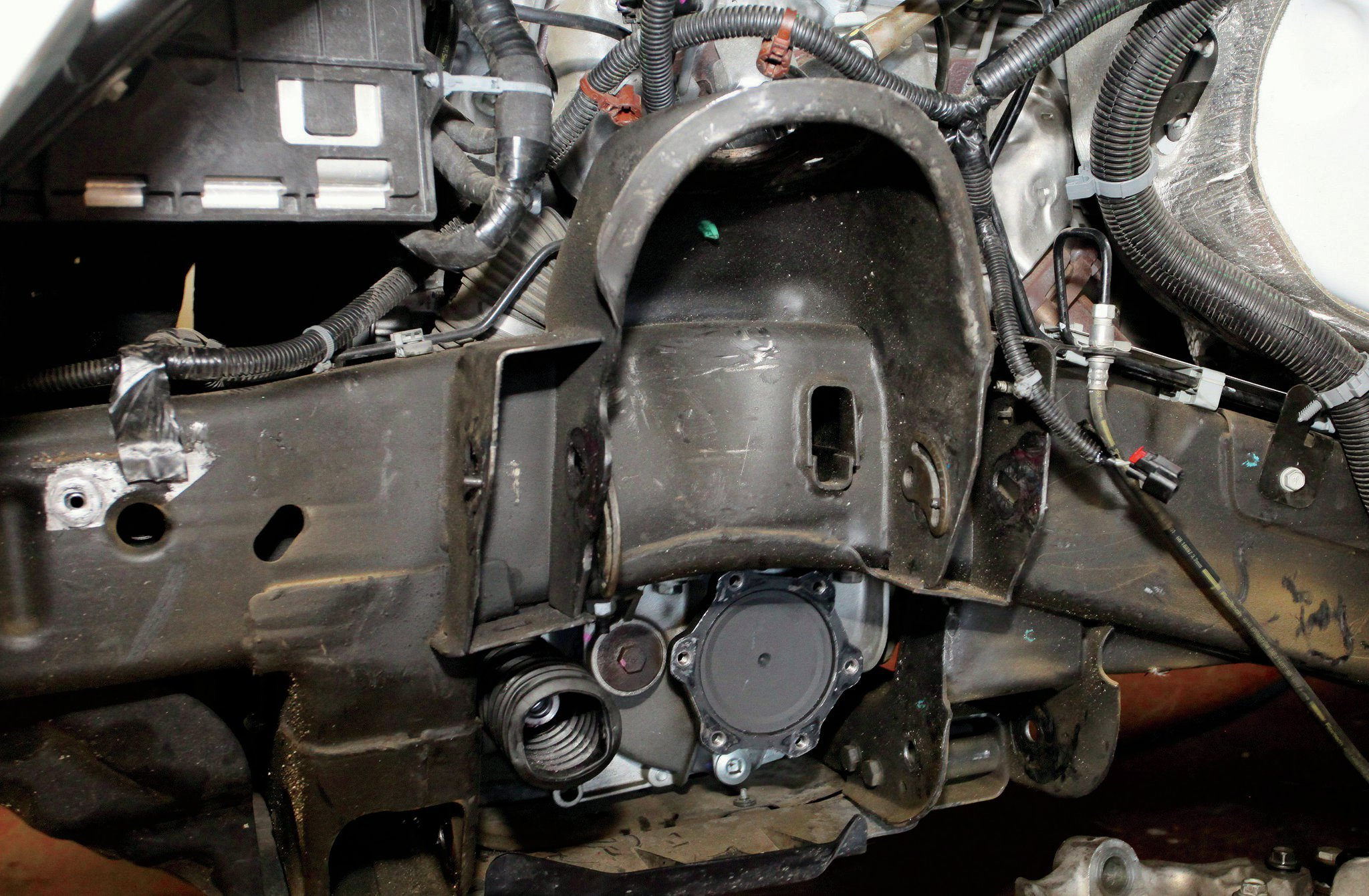 The only frame modification needed is the removal of the droop stop bracket (seen here already done). Note that the upper and lower A-arms, knuckle/hub assembly, axleshaft, and tie rod have been removed.