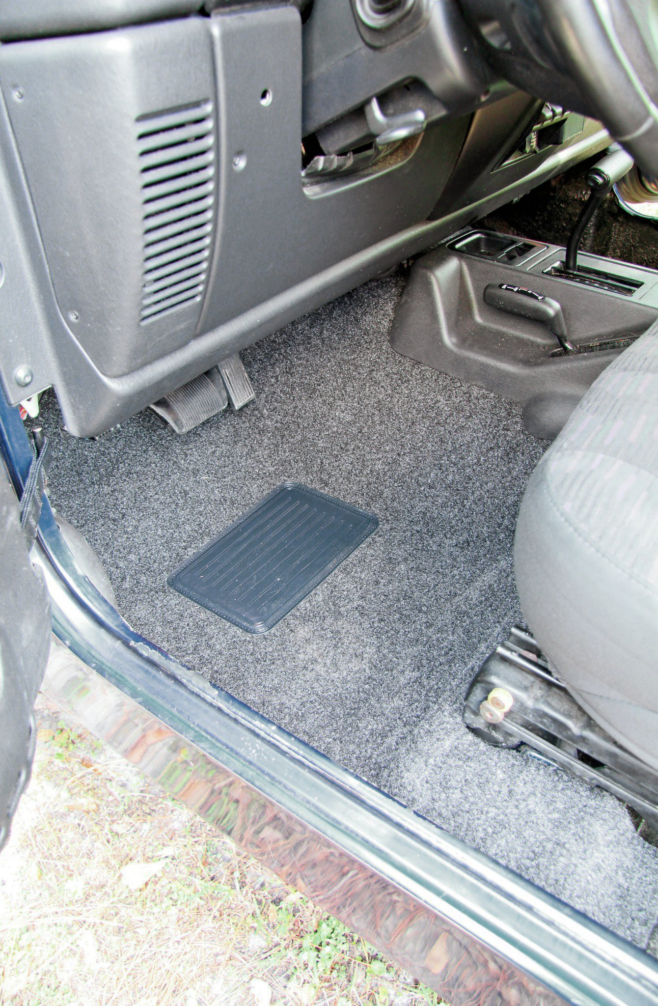 We've had carpet kits in the past that didn't fit well, so we were initially skeptical at how well the BedRug would fit. After we got the kit in place, all of our fears went away. While it takes a little nudging to get it snug under the seats and center console, the end result is a stock-like fitment.
