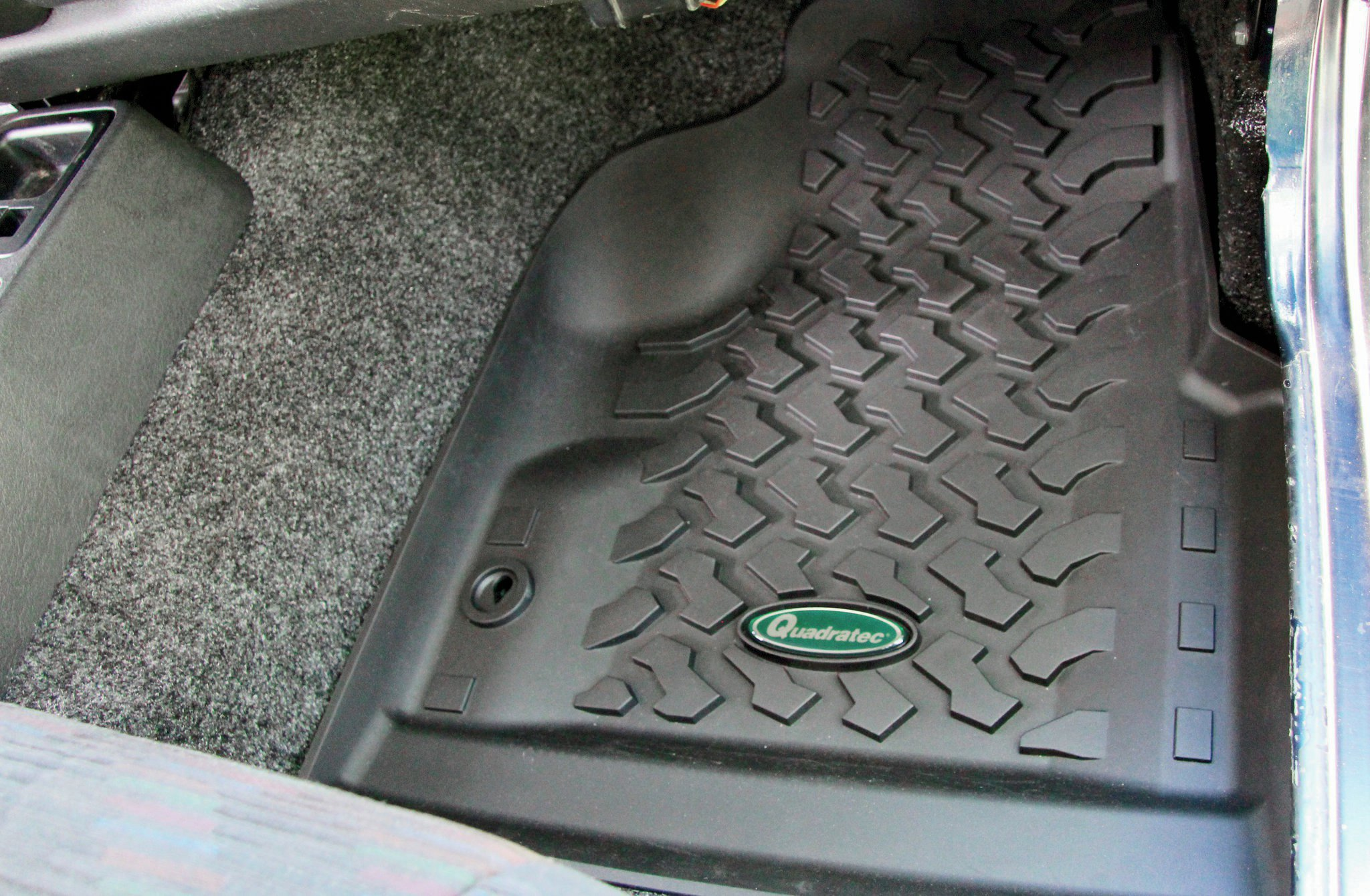 While the BedRug is designed to handle the elements with ease, a set of floor liners are a lot easier to hose off after a day in the trail. We picked up these form-molded liners from Quadratec. Like the BedRug, the Quadratec liners are formed specifically for the Wrangler's tub. Another plus: The liners are made in the USA!