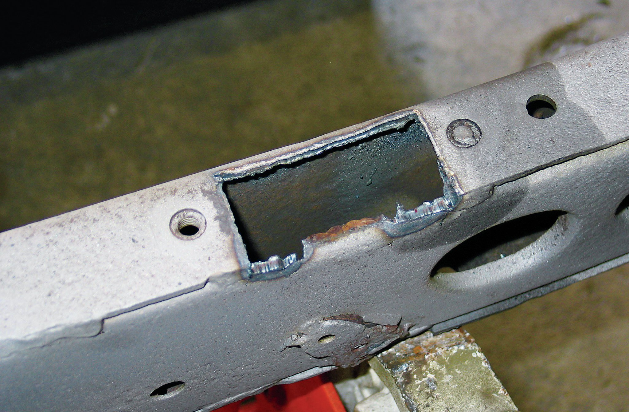 We used our Miller Spectrum 375 X-treme plasma cutter to remove the rust hole. Make sure you get into the non-rusted thicker material where you can throw down a solid weld. Once the cancer hole is cut out, you can clean it up with a grinder. Measure for a replacement piece that fits tightly.