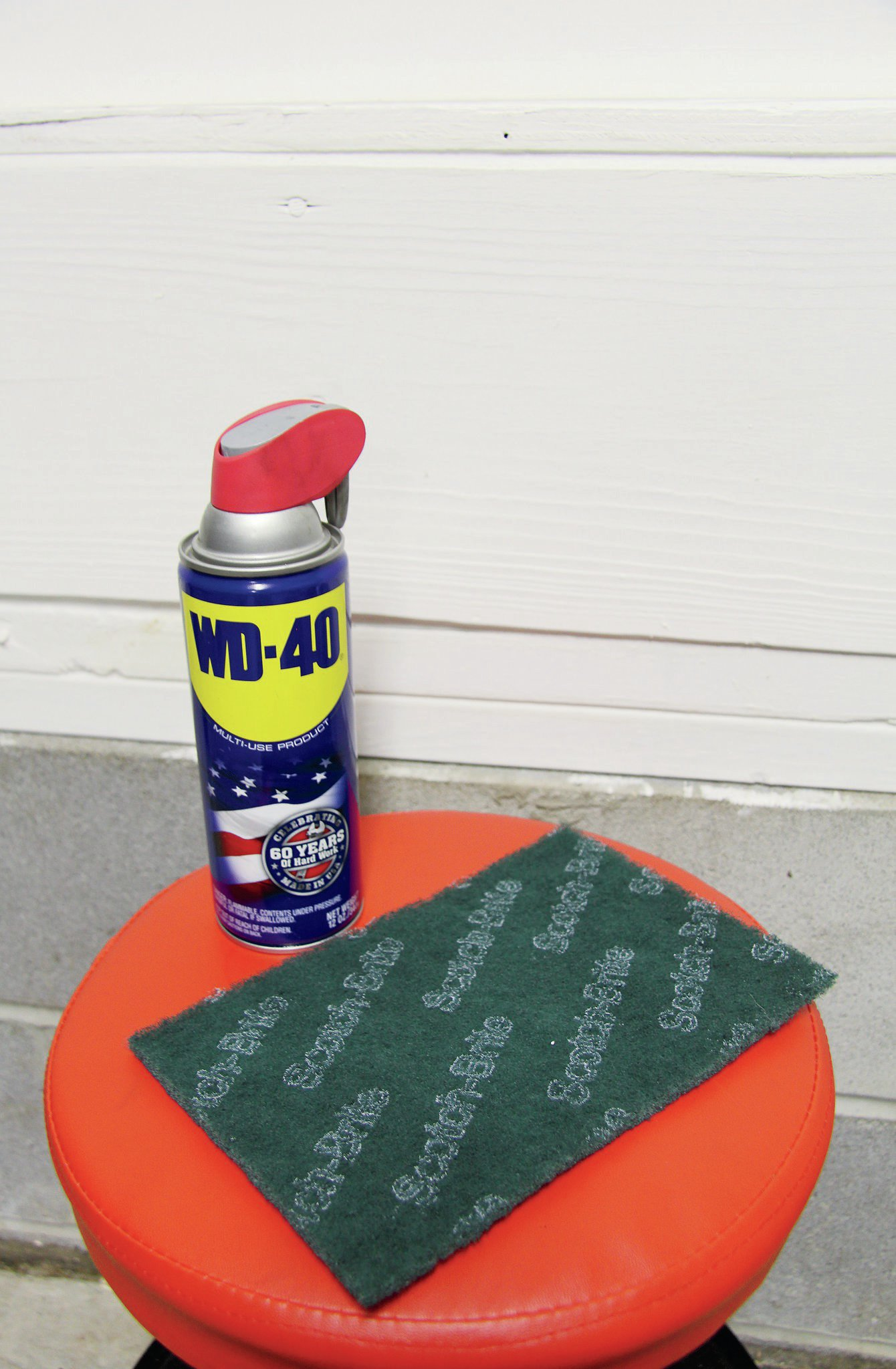 WD-40 is magic in a bottle. It can clean metal extremely well, remove and prevent rust, and even bring ancient parts back to life. One routine task we use it for is keeping our costly aluminum-bodied shocks in good shape. A few passes with a Scotch-Brite pad, along with a helping of WD-40, can go a long way in ridding rust and reviving the part. Fun fact, the WD stands for water displacement, while the 40 represents the 40th formula that ended up being the right one!