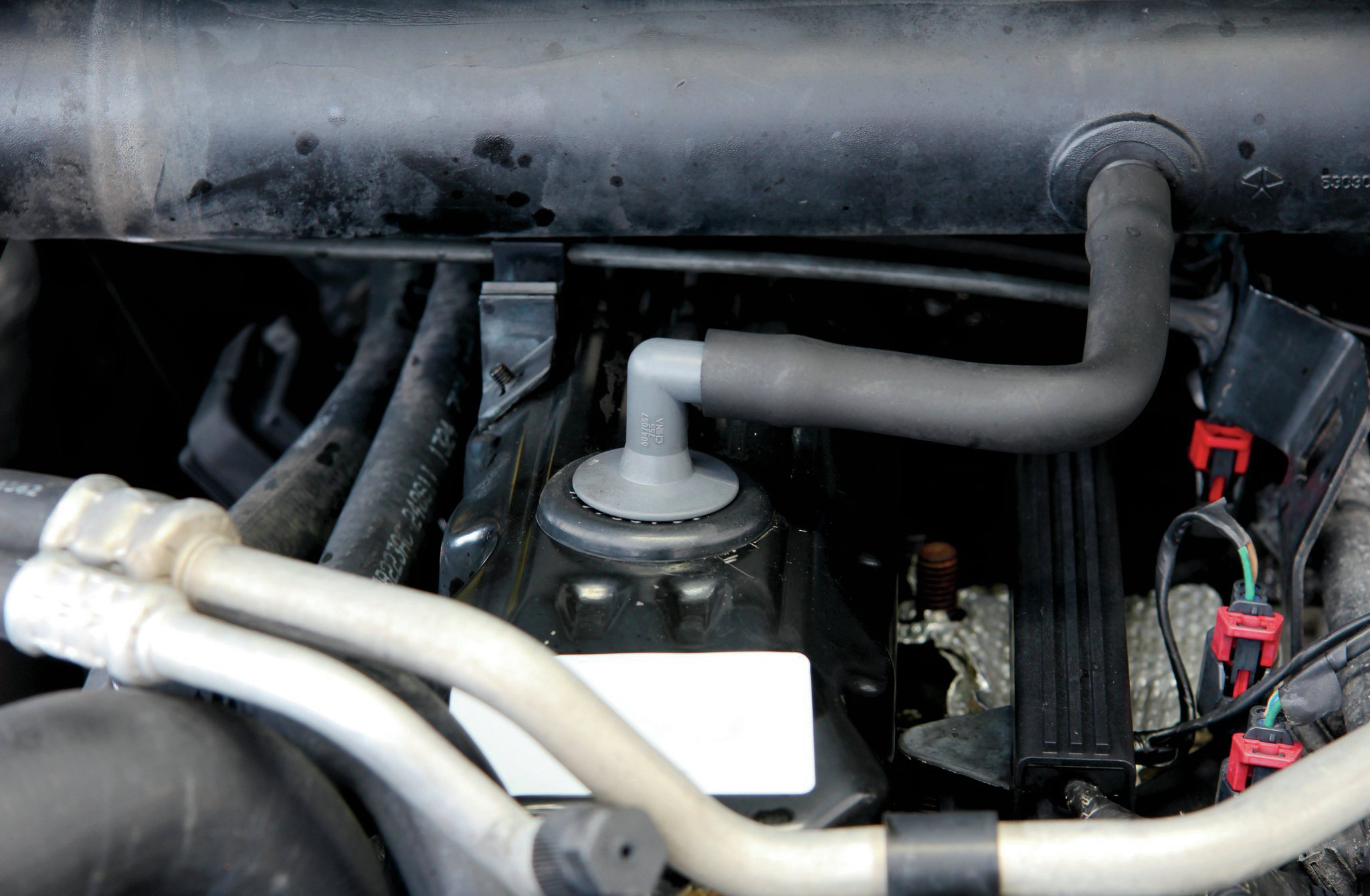 The 4.0L inline-six engine has a reputation for being reliable but leaky. A very common leak, which is sometimes misdiagnosed for a rear main seal leak, comes from the crank case vents on top of the valve cover. This, in combination with a slightly leaking valve cover, can cause oil to run down the back of the block. Replacing the valve cover gasket, along with the breathers and grommets, will cost you around $40.