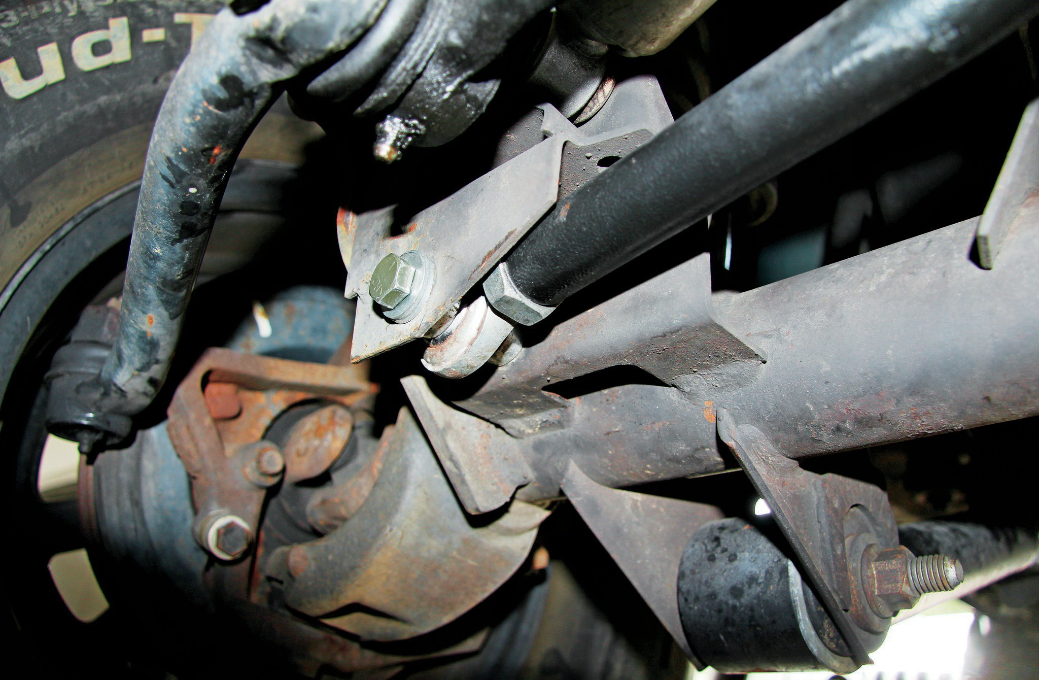 If you are looking at a lifted Wrangler and the front end feels a little shaky, we would eye the track bar mount at the axle. The bolt could simply be loose, but we've also seen the bolt holes deform into an oblong mess. This will require upping the track bar bolt size (along with a new joint) or replacing the bracket altogether. Another culprit is the bushing or rod end being worn. Have a friend rotate the steering wheel from left and right while you look closely at the track bar bushing. If you noticed the bar is moving or plunging significantly, it's likely the bushing is bad.