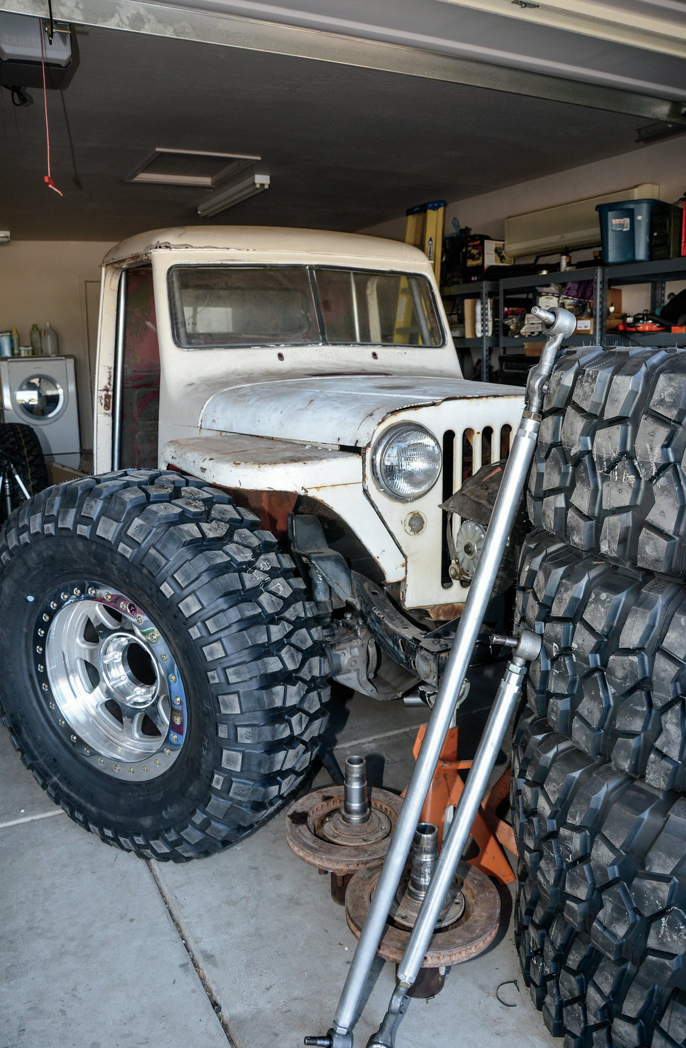 1949 willys pickup with pile of parts