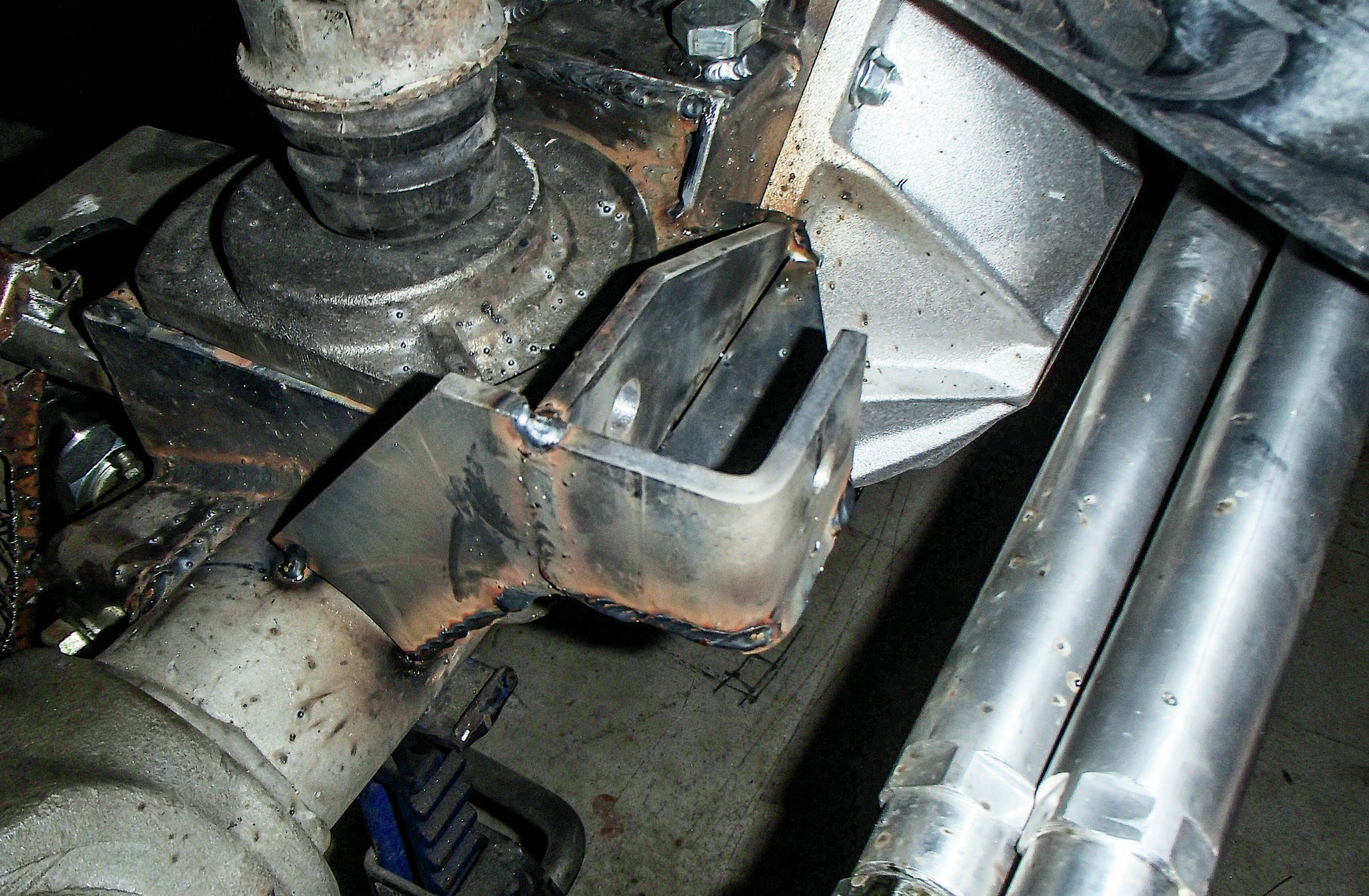 Once we got the drag link, tie rod, and pitman arm all mounted up on the Jeep, we could figure out how long our track bar needs to be and build mounts for it. For the axle end of the track bar mount, we built this bracket like those found on a stock TJ. We used 1⁄4-inch plate and our Swag Off Road bender to make the bracket. It's tack-welded in place until we are sure it's where we want.