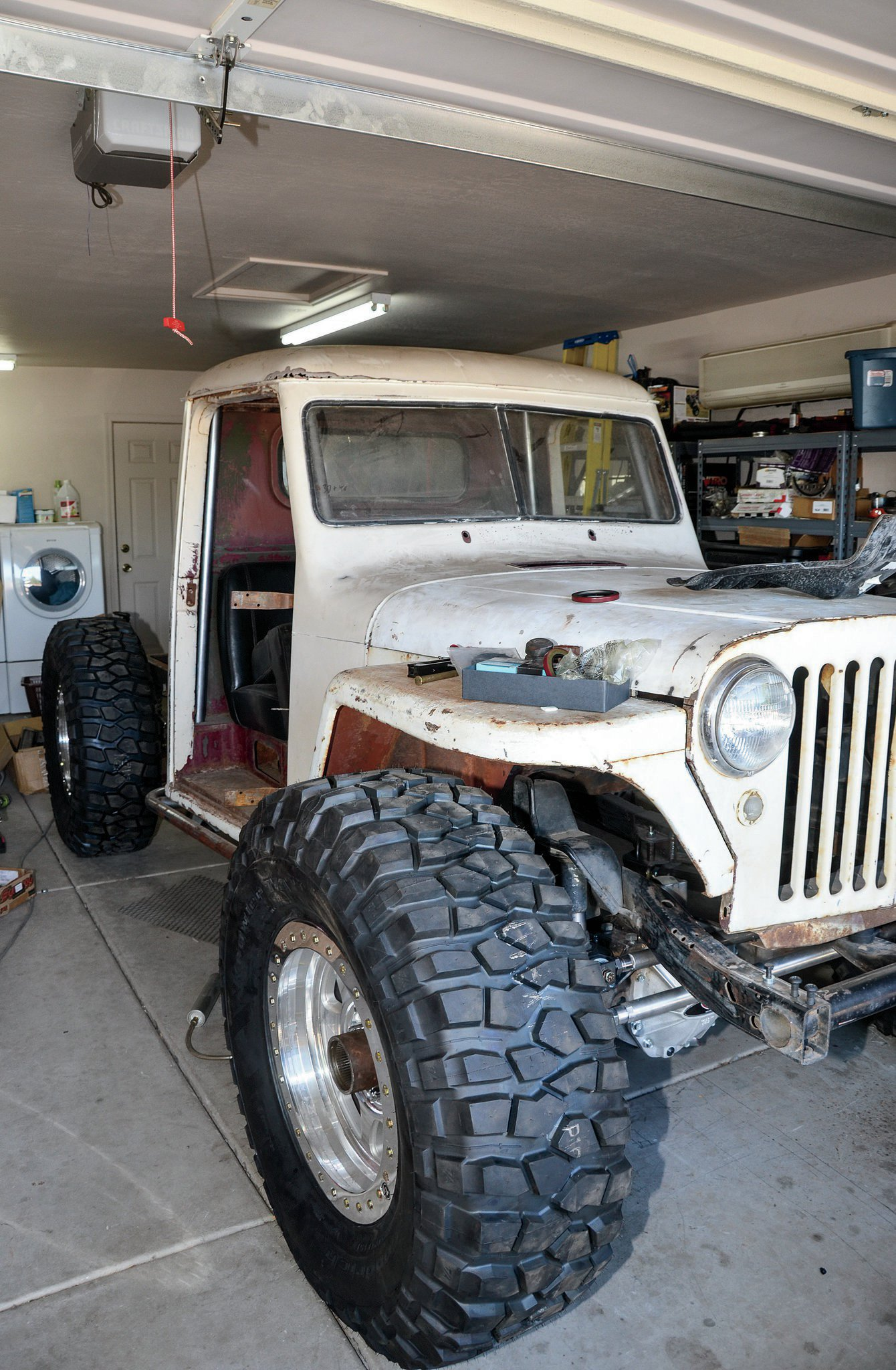 At the beginning of this article, we hinted at the fact that the Willys is now a roller. This is a huge milestone for a long-term build like this. As a teaser, here is the big truck on the tires at full bump. More to come.