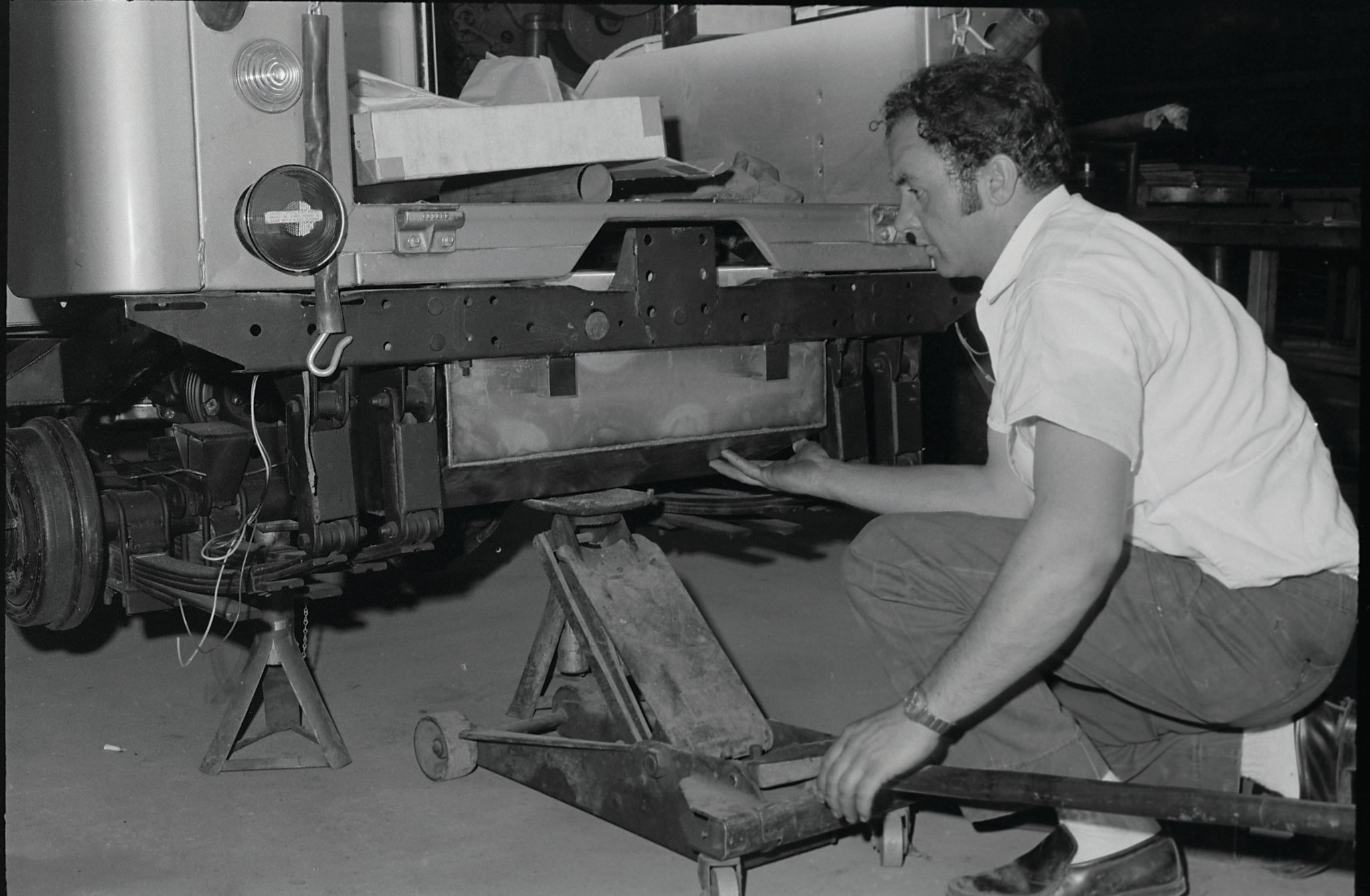 Chuck Atkinson fits the 30-gallon main tank up into frame. Two other tanks ride in the rear body corners.