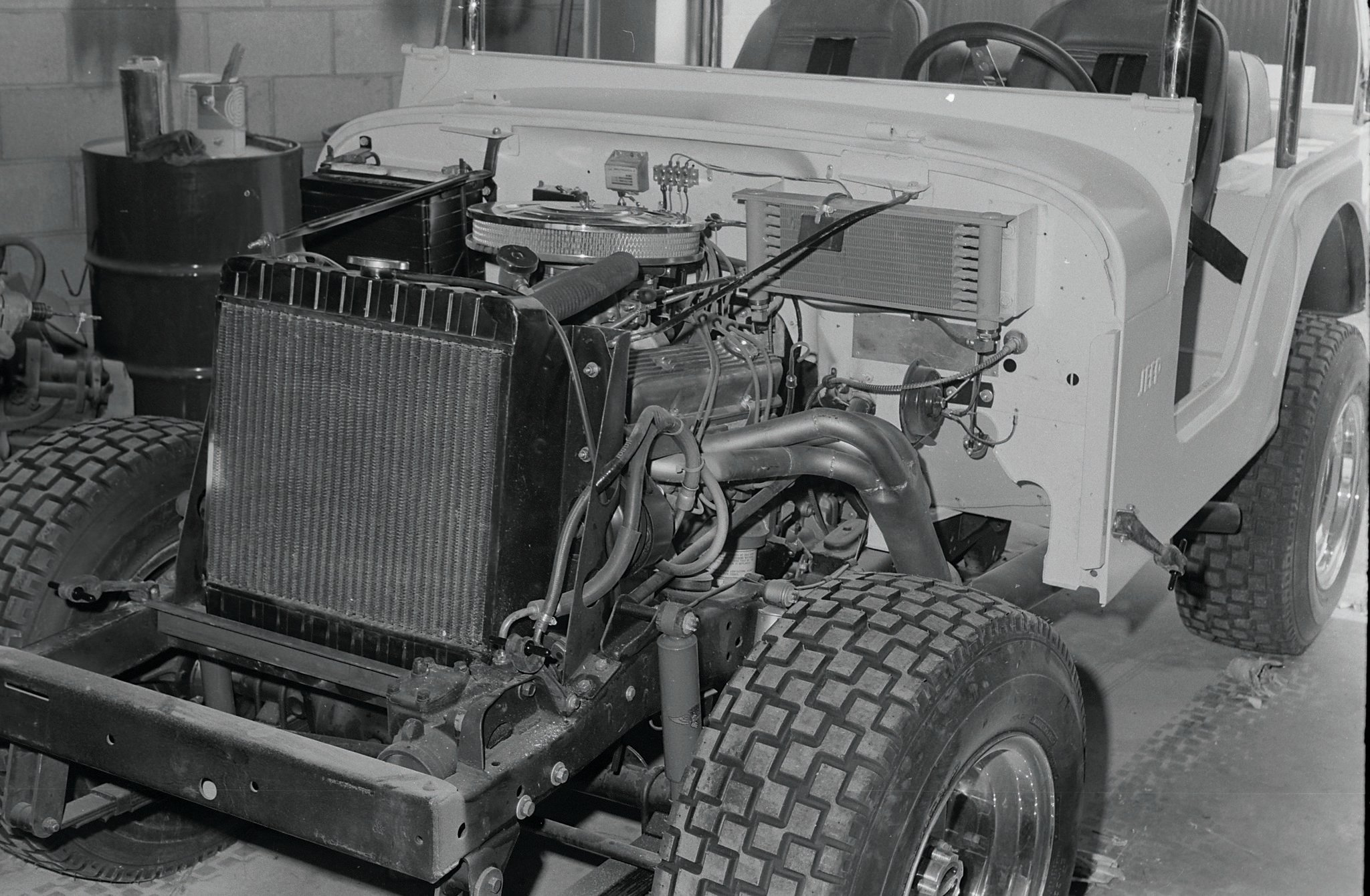 The powerhouse: a 350 Hi Perf Chevy with upswept headers. The Hayden trans cooler keeps things cool in the Turbo Hydro.
