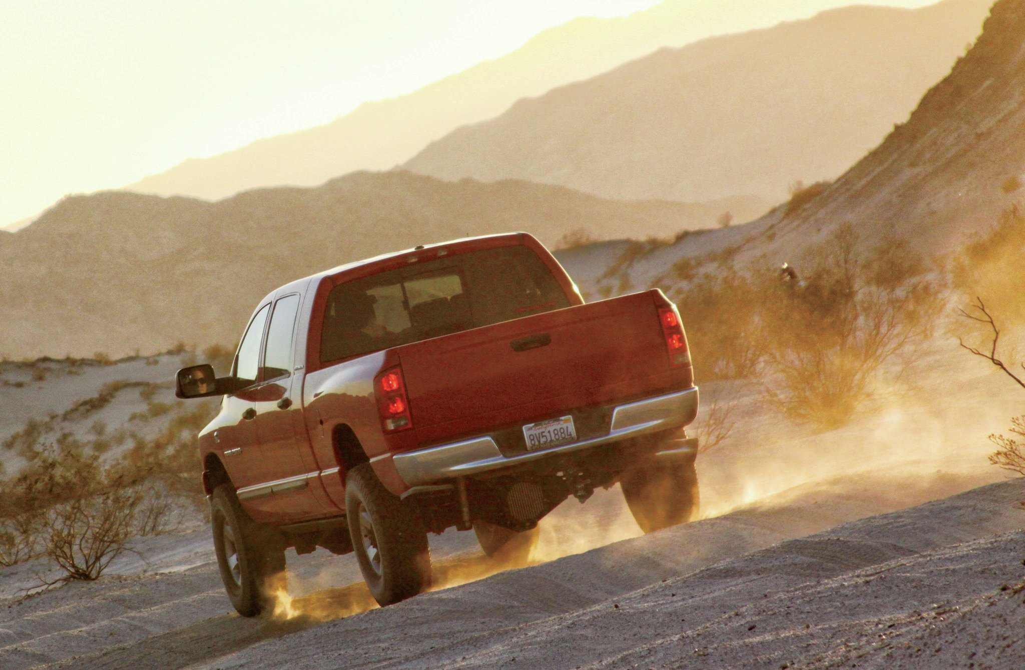 dodge ram driving down dirt road