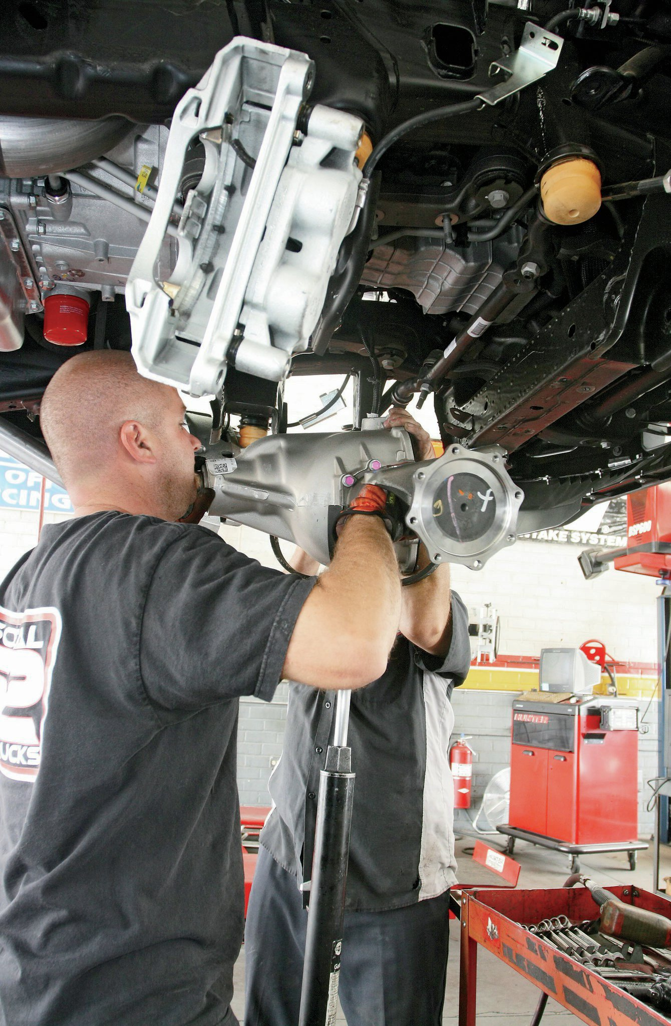 With a heavy-duty jack in place, the differential is lowered down out of the way.