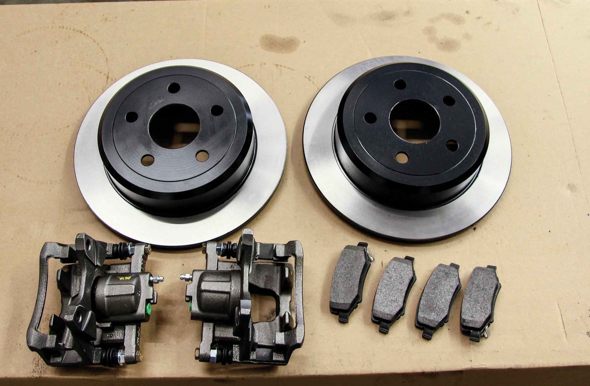 As we mentioned, we were starting from scratch in the brake department. For rotors and brake pads, we ordered a replacement set from the Jeep mega-parts house Omix-ADA. We purchased the calipers from our local parts house.
