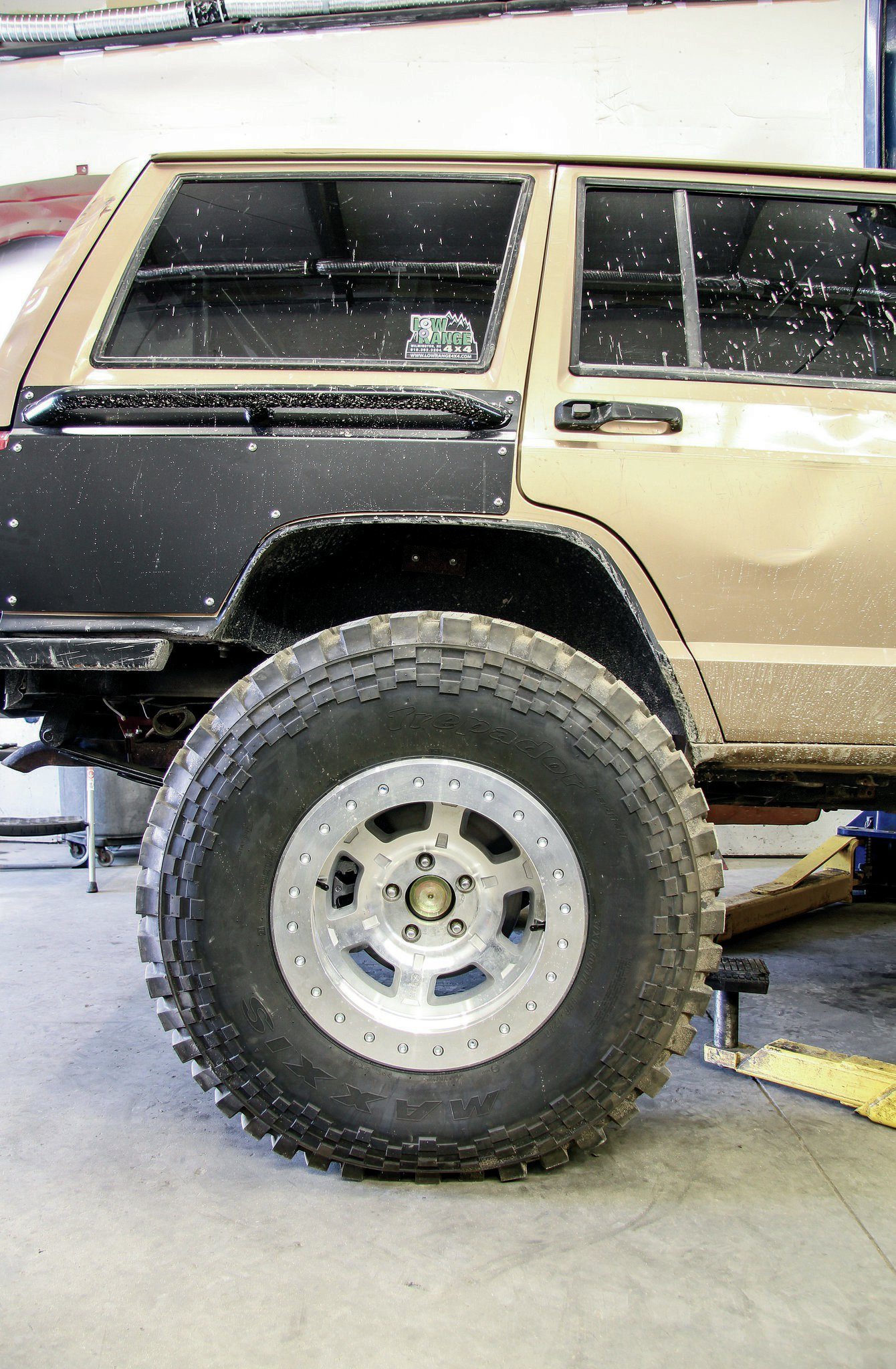 Here's a sneak peak at what we are looking at for a ride height. The Maxxis Trepador M8060 37x12.50R17 tires are mounted on 17x9 ATX Chamber Pro II beadlock wheels. The 4-inch backspacing doesn't quite push the tires completely out from under the XJ. So, we have a bit more trimming and bumpstop engineering to do to maintain the 4.5-inch lift height.