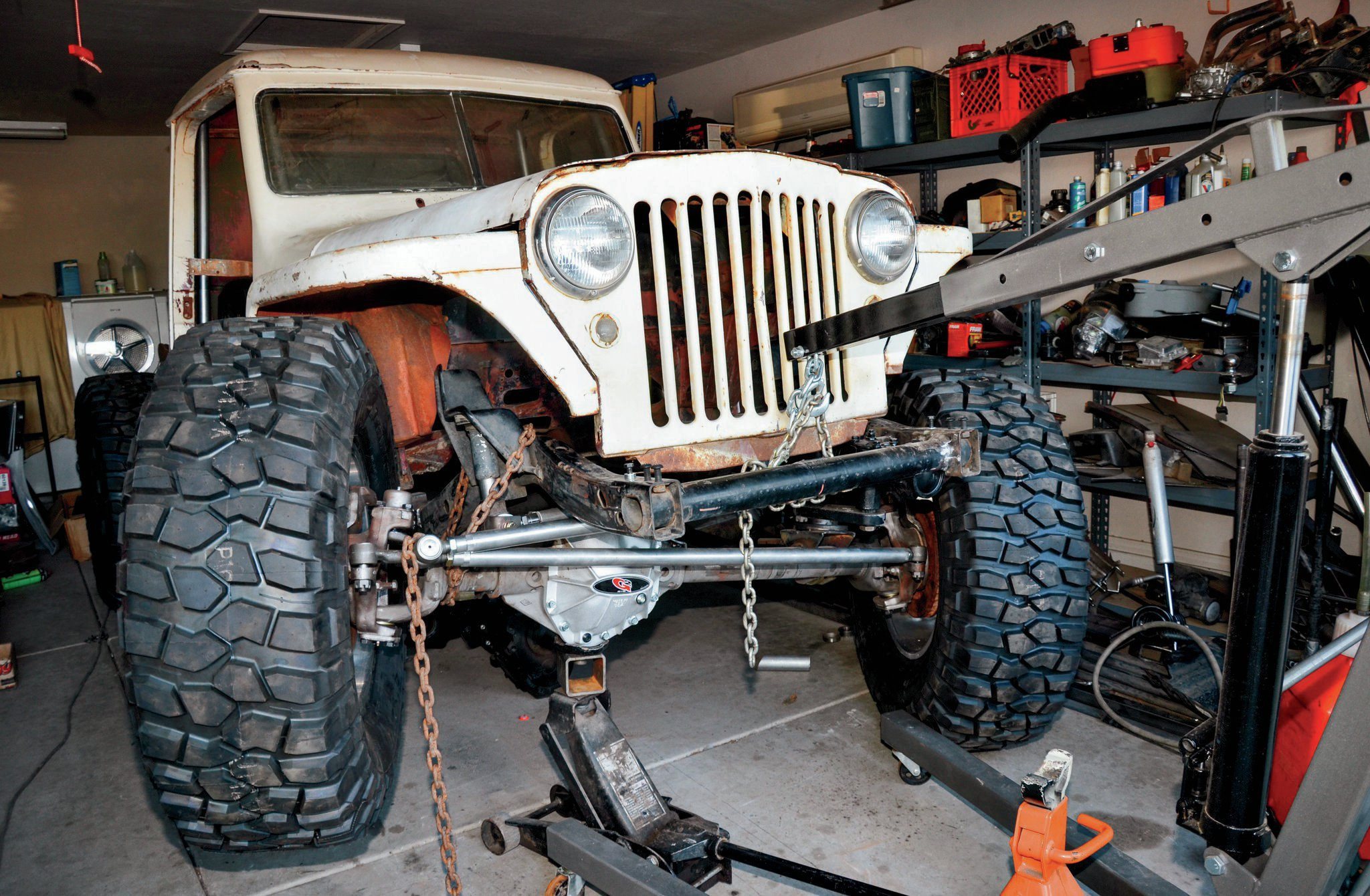 Cycling the suspension also allows us to measure for shocks and make sure that the springs that we wanted to use will work. Our plan is to use a mixture of Old Man Emu springs and shocks that should work with our TJ-style shock and spring mounts front and rear. Yeah, this thing is not going to max out any RTI-ramps, but a low-slung, powerful Jeep on large tires is a proven formula that we like.