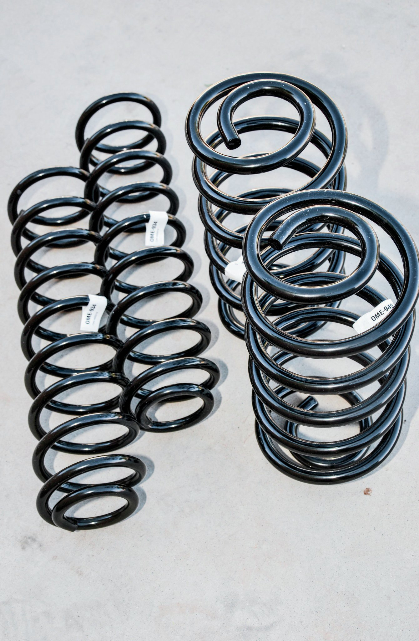 To add some boing in our front end, we are going to use a set of ZJ coils from Old Man Emu (PN 2934). These have a slightly higher spring rate and static height than Old Man Emu's 2-inch TJ springs. This should help deal with the heavier engine, axle, and large tires on our Willys. Out back, we are going to use Old Man Emu's 2-inch lift coils intended for an LJ (PN 2949). These springs also have a higher spring rate than the regular 2-inch lift OME TJ coils and a similar static height. If the springs don't provide enough lift or it's not level, we can always add coil spacers.