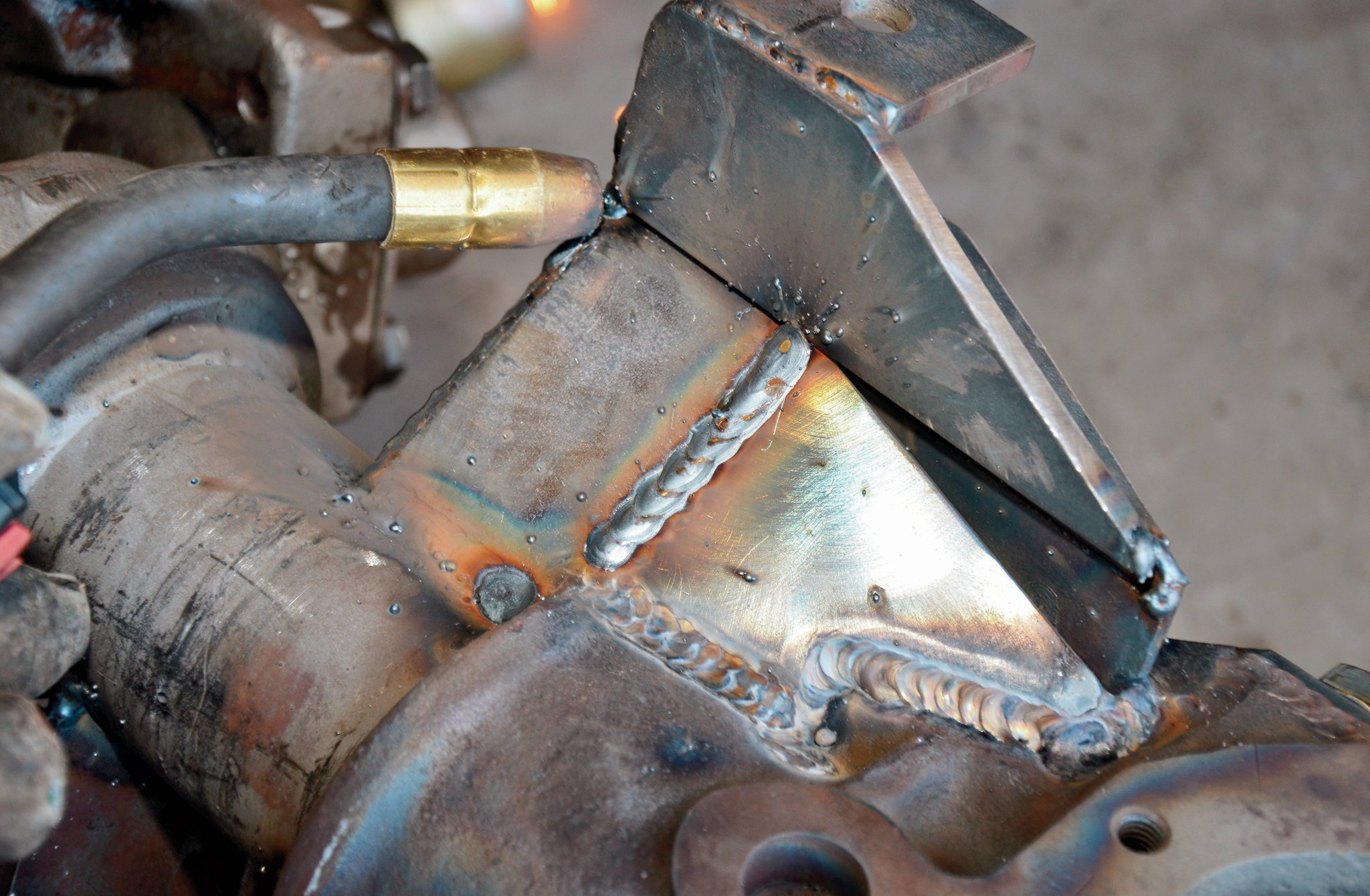 After the axlehousing cooled and we were able to drag it home, we can finally get down to finish-welding all the brackets with our old Hobart MIG welder. With any luck, we won't have to change any of the mounting locations on the axle or frame. Creating good-looking welds comes from practice, practice, and more practice. Also, being sure to clean all of the areas you are going to weld before starting makes a huge difference.