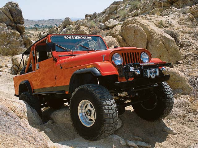 04014wd 03z+1982 Jeep CJ8 Scrambler+Front Passengers Side View On Rocks