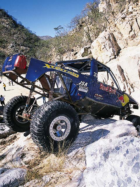 A one-time competition cliff diver, Dustin Webster now gets his thrills on the rock course in his Red Bull-sponsored '01 Chevy S-10 rockcrawler.