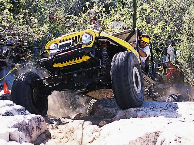 Charlie Copsey spins the tires of his Jeep CJ as he crests the peak of Obstacle Three.