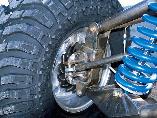 0308or 05z+2002 Olsen Truggy+Behind Tire Shot Showing Spring And Suspension