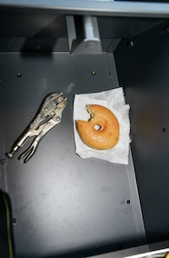 doughnut and pliers inside center console
