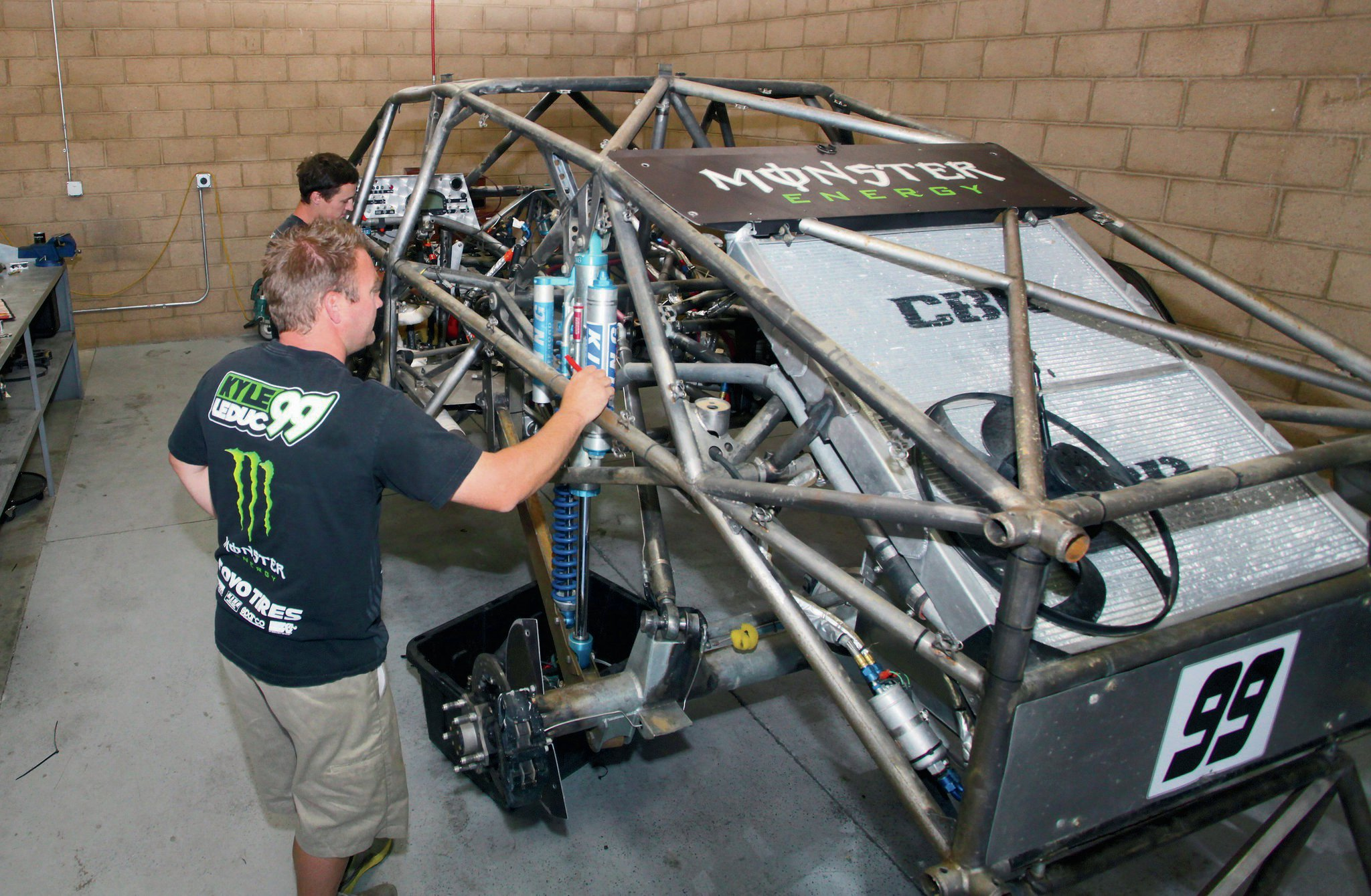 Kyle Leduc looks over the Monster Energy Pro-4 at his race shop.