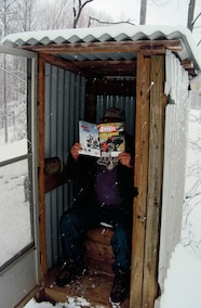 reading petersens in the outhouse