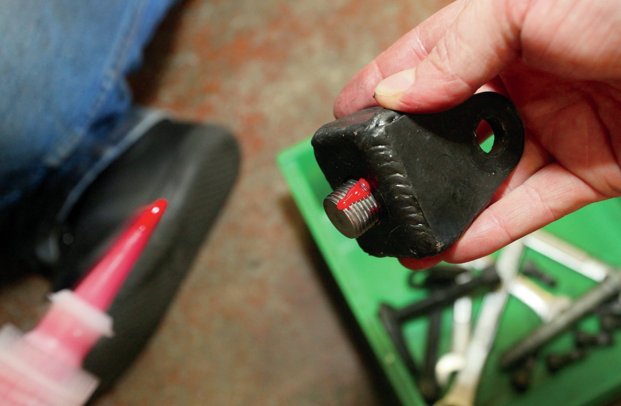 A healthy application of Loctite is applied to the bolt that holds the Clevis in place.