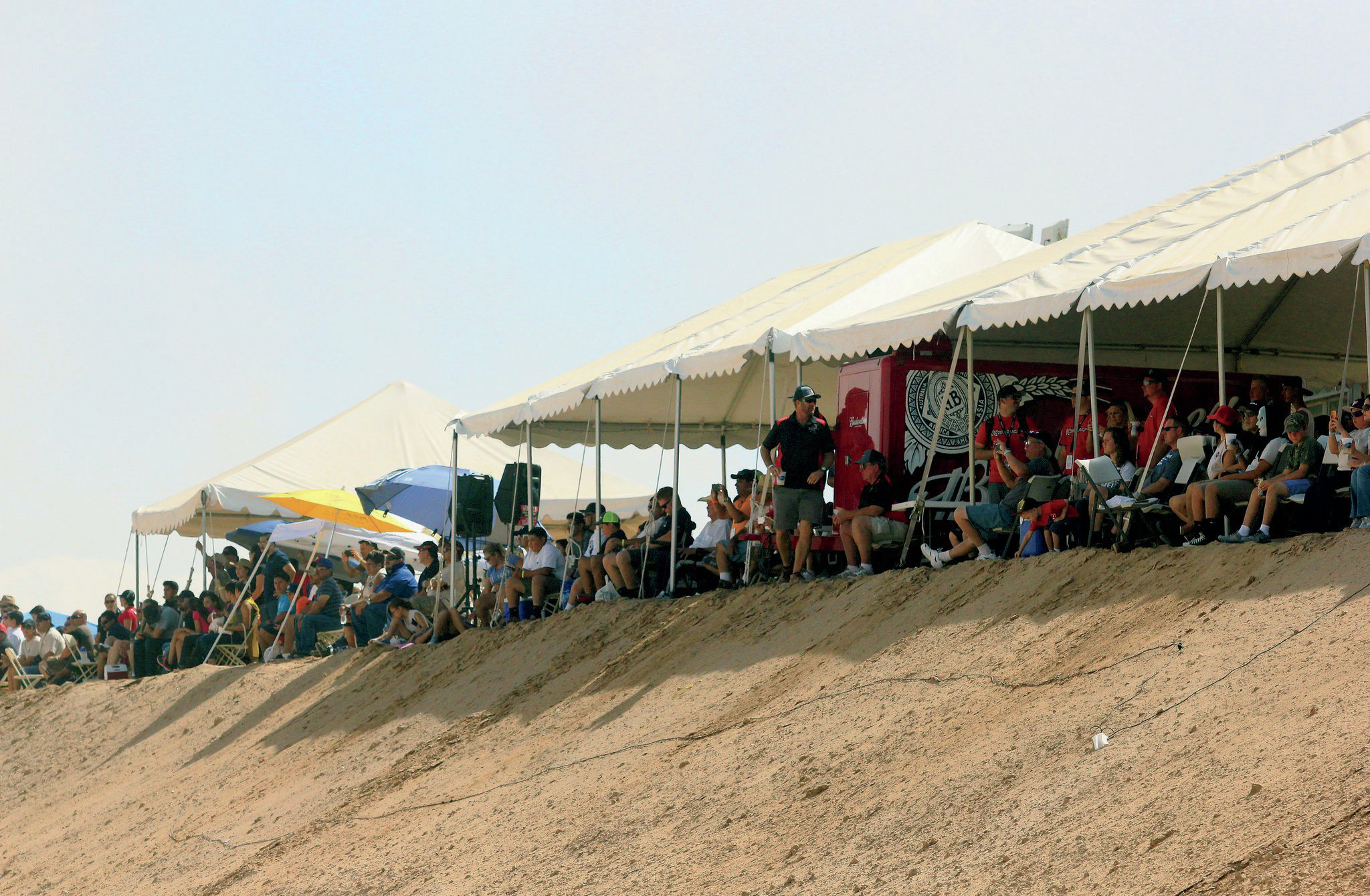 Fans get a front-row seat to watch racing action at the only paid spectator area.