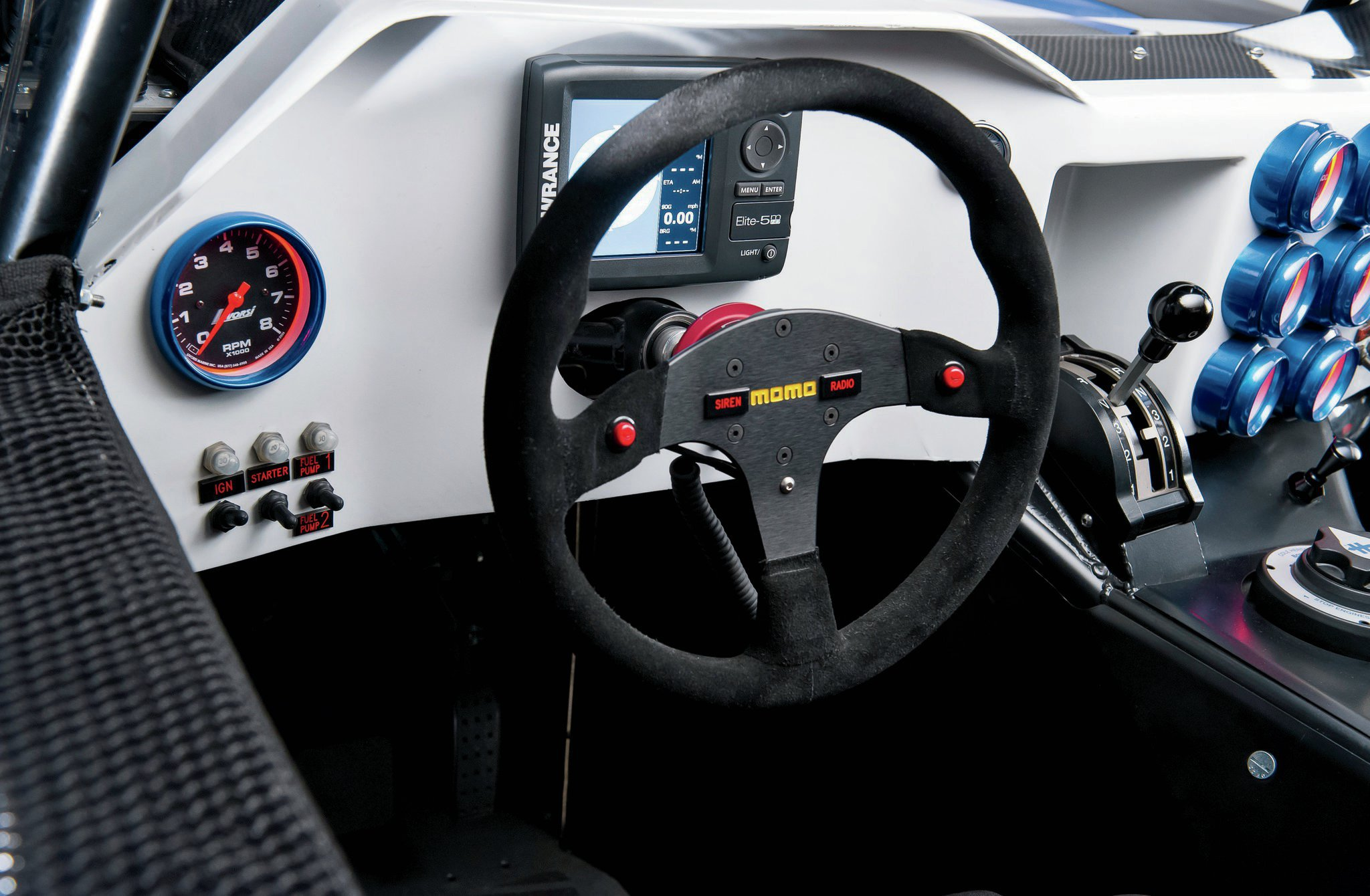 The driver gets their own Lowrance unit along with a Livorsi tachometer while the MOMO steering wheel and Winters shifter give him full control over the truck.