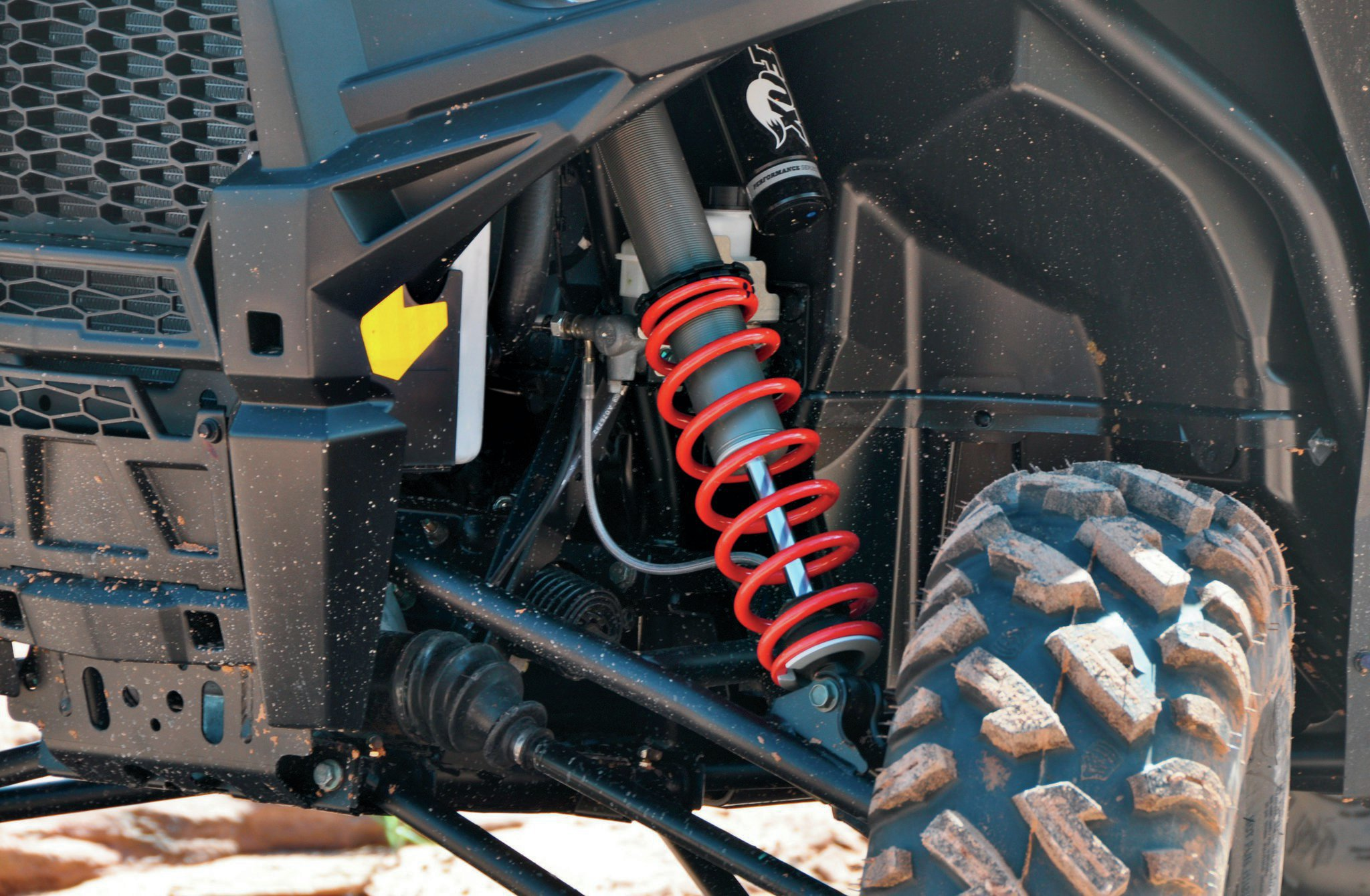 The RZR S front shocks feature Fox Podium X 2.0 with piggybacks. A-arms are standard RZR S with GBC Dirt Commander Tires (27x9x12 front and 27x11x12 rear).