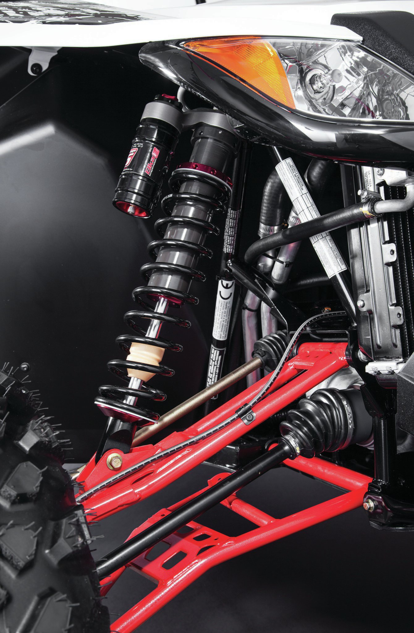 The Arctic Cat features a double A-arm front/rear suspension with rear sway bar featuring 12.2/12.6 inches of travel, with 13 inches of ground clearance (shown with JRI shocks).