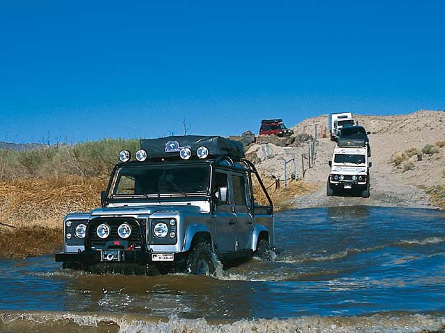 03084w 17z+Land Rover+Front Driver Side View Cars Over River